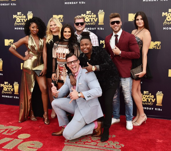"""Cast members of """"Floribama Shore"""" pose on the red carpet for the MTV Movie & TV Awards on June 18, 2018, in Santa Monica, Calif. That's Jeremiah Buoni in foreground, and from left: Candace Rice, Alabama native Aimee Hall, Nilsa Prowant, Codi Butts, Kirk Medas, Gus Smyrnios and Kortni Gilson. (Photo by Alberto E. Rodriguez/Getty Images for MTV)"""