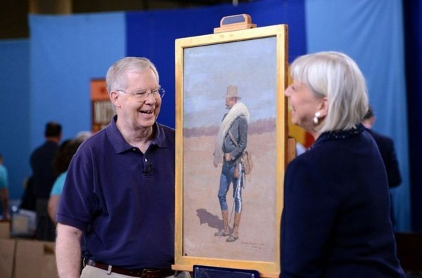 """Ty Dodge of Mountain Brook, Ala., is pictured here with the Frederic Remington oil painting of his great-grandfather, Army officer Lea Febiger. The painting and a letter that goes along with it were appraised by """"Antiques Roadshow"""" appraisal expert Colleene Fesko, right, for $600,000 to $800,000 at auction. (Photo by Meredith Nierman for WGBH, (c) WGBH 2014)"""