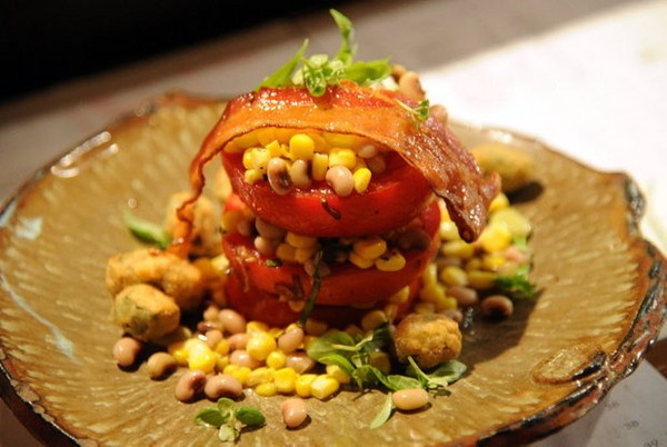 """The Hot and Hot Tomato Salad at Hot and Hot Fish Club in Birmingham, Ala., is featured on the Alabama Tourism Department's list of """"100 Dishes To Eat in Alabama Before You Die."""" (Birmingham News file/Hal Yeager)"""