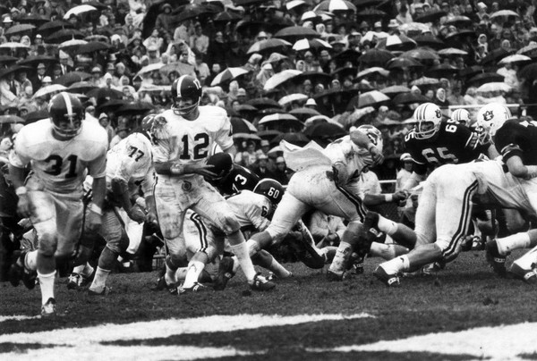 Kenny Stabler's run in the mud lifted Alabama to a 7-3 win over Auburn at Legion Field, Dec. 2, 1967. (Tom Self)