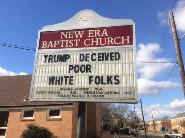 "A sign put up in January at New Era Baptist Church in Birmingham says ""Trump deceived poor white folks."""
