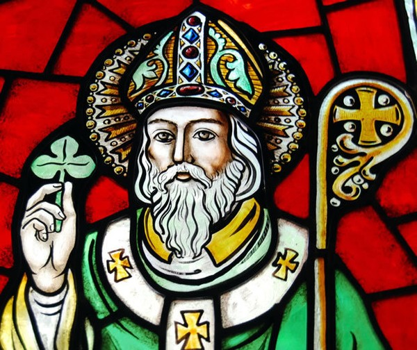 St. Patrick is commemorated in stained-glass windows and statues worldwide. (St. Thomas Aquinas Chapel, Brooklyn, N.Y.)