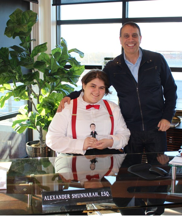 Eli Stephens, a Helena High School senior, poses with attorney Alexander Shunnarah behind the lawyer's desk for one of his senior pictures (Ivana Hrynkiw | ihrynkiw@al.com)