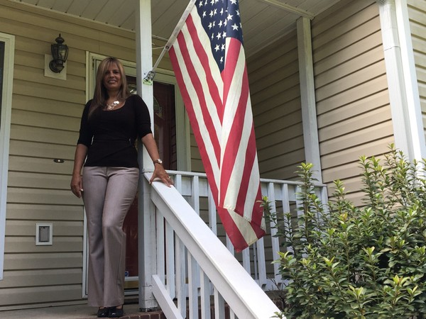 Ana Nunn, who immigrated into Alabama from Brazil in 1997, stands in front of her McCalla home a few hours before she became a U.S. citizen at the United States Citizenship and Immigration Services Montgomery field office on Aug. 14, 2018.