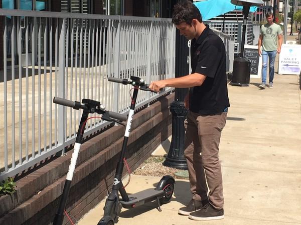 John Lasater returns a Bird scooter outside Hattie B's in Birmingham's Lakeview District. (Erin Edgemon/eedgemon@al.com)