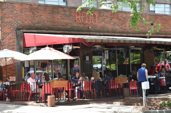 Rojo has a packed lunchtime crowd under an awning and umbrellas. Great places to dine outdoors around Birmingham, Alabama. (Frank Couch\fcouch@al.com)