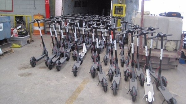 About 90 Bird scooters (not all pictured) have been impounded in the city of Birmingham.