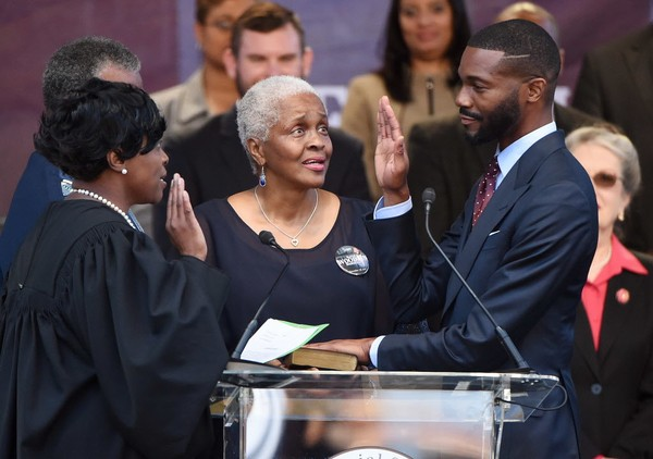 Randall Woofin is sworn in by Judge Nakita Blocton (left) as Woodfin's mother Cynthia Woodfin-Kellum looks on. Randall Woodfin is inaugurated as the 30th mayor of the City of Birmingham Tuesday November 28, 2017 in front of Birmingham City Hall. (Joe Songer | jsonger@al.com).