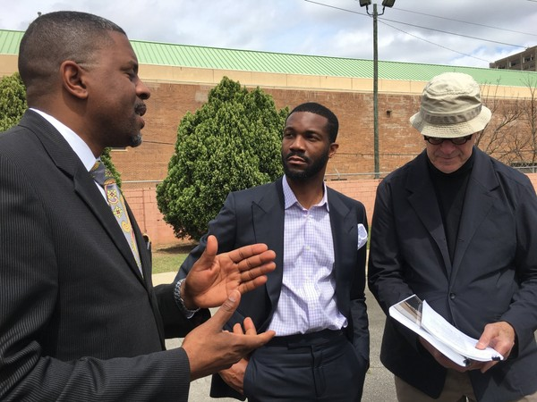 Birmingham Mayor Randall Woodfin (center) gets an update on the restoration of the A.G. Gaston Hotel from architect Jack Pyburn (right) on March 28, 2018. Pictured to the left is Woodfin's senior adviser Ed Fields. (Erin Edgemon/eedgemon@al.com)