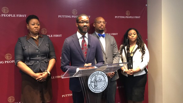 Birmingham Mayor Randall Woodfin (center) held a press conference on April 30, 2018 to announce the formation of the Re-Entry Task Force. Pictured from the left are: Stephanie Hicks of the Offenders Alumni Association; Woodfin; Brandon Johnson, director of the city's Community Engagement Office; and Kerri Pruitt of the Dannon Project
