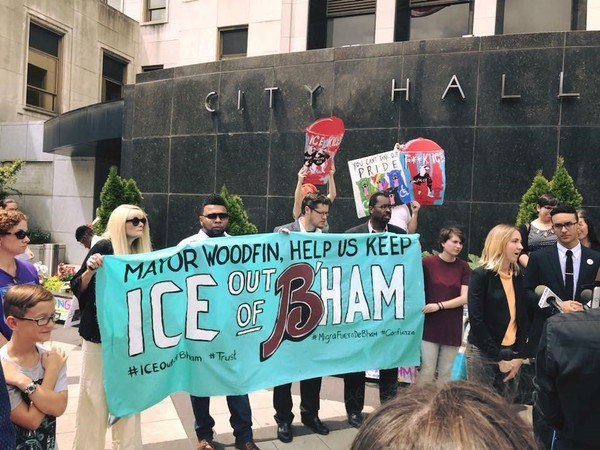 The Alabama Chapter of Council on American-Islamic Relations, a Muslim civil rights group, and Adelante Alabama Workers Center, along with coalition partners, faith and civic community leaders held a protest at Birmingham City Hall on Tuesday to call on Woodfin to sign the order.