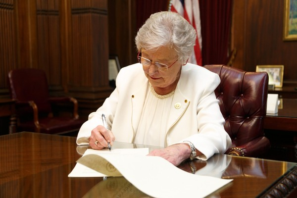 Gov. Kay Ivey signing a state of emergency declaration on March 20, 2018 (Contributed)