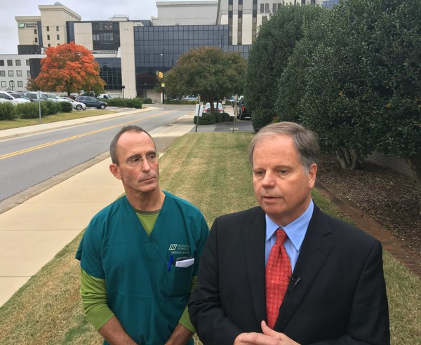 Democratic Senate candidate Doug Jones, right, discusses health care issues with reporters in Huntsville last week. He's accompanied by Huntsville cardiologist David Drenning. (Paul Gattis/pgattis@al.com)