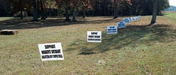 Just over a year ago, when deputies arrived to find Jason Klonowski's lifeless body posed in a chair in the backyard, these protest signs lined the man's front yard just outside Huntsville along busy Highway 53. The state would soon take over the murder investigation.
