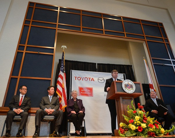 Tommy Battle takes his turn at the podium during the formal announcement Jan. 10, 2018, that Toyota and Mazda were uniting to built an automotive plant in Huntsville. Gov. Kay Ivey is seated to Battle's right. (AL.com file photo/Julie Bennett)