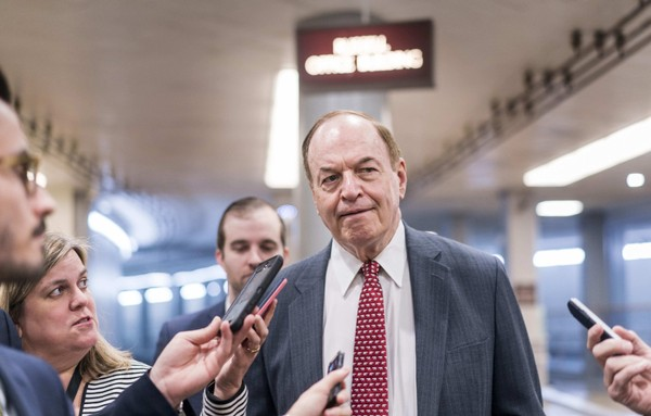 Sen. Richard C. Shelby, R-Ala., stops to speak to reporters before votes on the Senate floor on Nov. 15. MUST CREDIT: Washington Post photo by Melina Mara