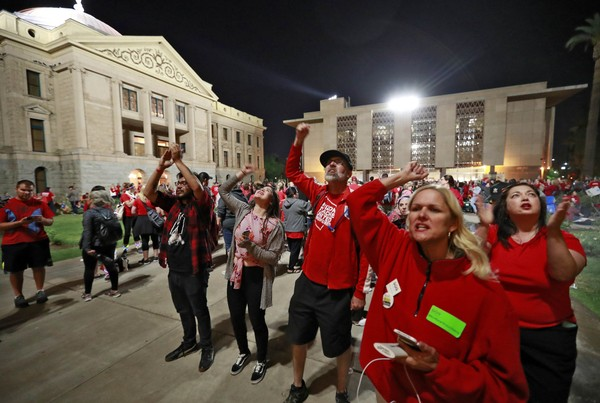 Teachers in Arizona marched for higher wages and better school funding last month in Phoenix. Alabama teachers did receive a pay increase, but some wonder if it's enough to keep protests from happening here. (AP Photo/Matt York)
