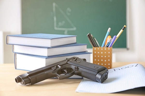 The national debate over arming teachers and other school personnel is pushing its way as a top issue in political campaigns throughout Alabama, and is expected to be a big issue this fall. (Jeff Amy, Associated Press)