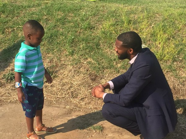 Alabama 4-year-old superhero 'President Austin,' aka Austin Perine, meets with Birmingham Mayor Randall Woodfin Thursday at the site of a new homeless shelter. Austin donated $5,000 from the GoFundMe account he is using to feed Birmingham's homeless. (Contributed photo)