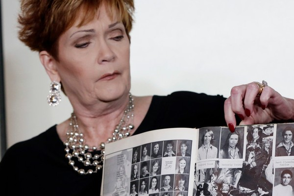 Beverly Young Nelson points to her photo in her high school yearbook during a news conference in New York, Monday, Nov. 13, 2017. Nelson says Roy Moore assaulted her when she was 16 and he offered her a ride home from a restaurant where she worked. Moore has denied the allegations. (AP Photo/Richard Drew)