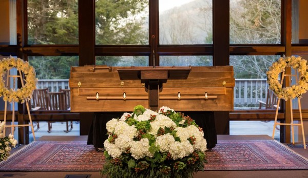 The body of Billy Graham--in a simple casket made of pine--rests behind a pulpit at The Billy Graham Training Center at The Cove in Asheville, N.C. The casket was made in 2006 by inmates at Angola Prison in Louisiana. (Contributed photo/Billy Graham Evangelical Association)