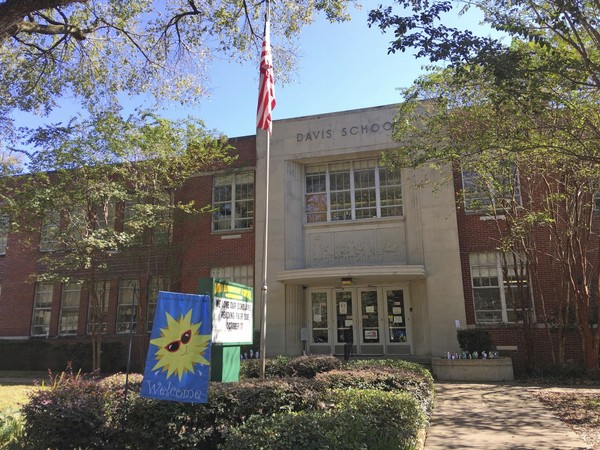 Davis International Baccalaureate Elementary School in Jackson, Miss., photographed Wednesday, Oct. 18, 2017, is shedding the name of Jefferson Davis, the Confederacy's only president and will instead be named for Barack Obama, the first African-American president of the United States. In a move proposed by parents, the school with 98 percent African-American enrollment is slated to be renamed for Obama, starting next academic year. The PTA president announced the planned change at a school board meeting Tuesday. (AP Photo/Emily Wagster Pettus)