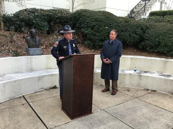 Alabama State Trooper Association President David Steward, speaking, and Executive Director Neil Tew.