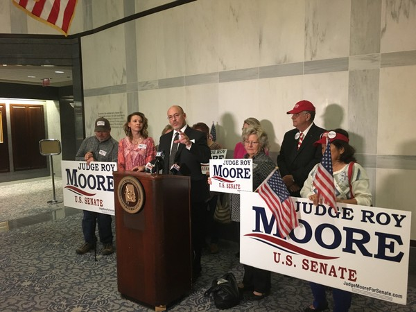 Dean Young and other Roy Moore supporters appear at a press conference in Montgomery on Nov. 16, 2017.