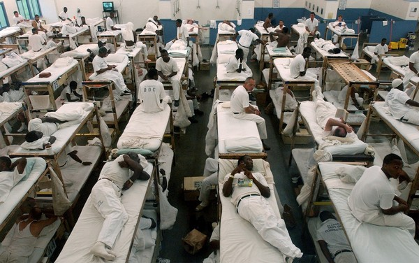 Prisoners lie and sit in their bunks during a head count at Alabama's Donaldson Correctional Institution in 2002.