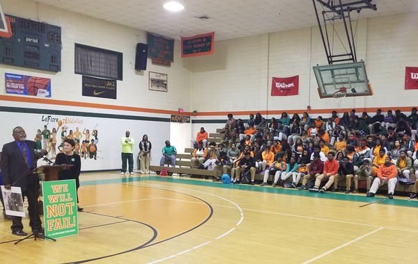 """Mobile City Councilman Fred Richardson speaks to students at LeFlore High School on Friday, March 23, 2018. To help support and motivate students at a school labeled as """"failing,"""" Richardson distributed badges with the slogan """"We Will NOT Fail!"""" At his side is Christy Gonzalez, who designed the logo. (Lawrence Specker/LSpecker@AL.com)"""