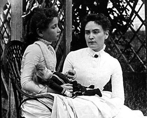 Helen Keller, seated, and her teacher, Anne Sullivan, at Ivy Green in Tuscumbia. (File photo)