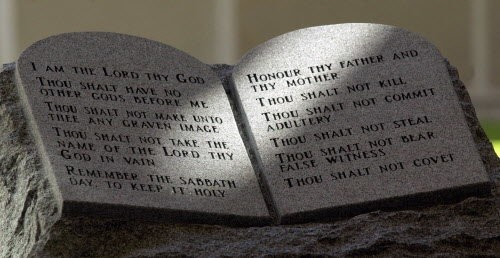 Light streams across the face of the Ten Commandments memorial in the lobby of the rotunda of the state judicial building in Montgomery, Ala., on Friday, Sept. 28, 2001. A federal judge later ordered the monument removed in a case that led to the removal of Roy Moore as Alabama Supreme Court chief justice. (AP Photo/Dave Martin)
