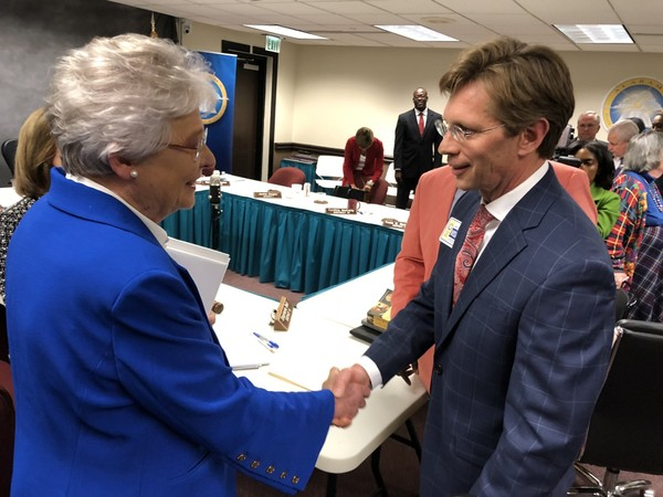 Alabama Governor Kay Ivey congratulates new Alabama State Superintendent Eric Mackey on April 20, 2018, in Montgomery, Ala.