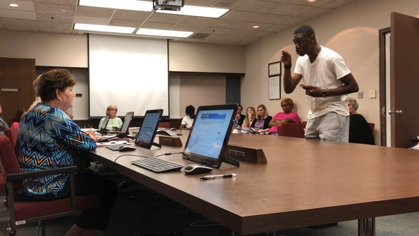 Birmingham activist Carlos Chaverst confronts Jefferson County Board of Education member Donna Pike during the June 12, 2018, board committee meeting in Birmingham, Ala.