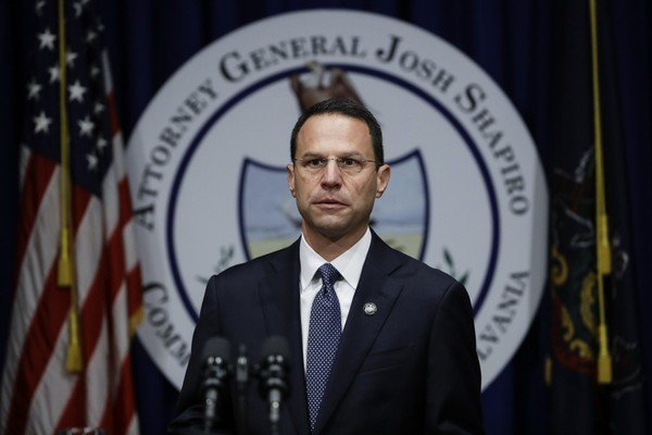 Pennsylvania Attorney General Josh Shapiro walks to the podium during a news conference at the Pennsylvania Capitol in Harrisburg, Pa., Tuesday, Aug. 14, 2018. (AP Photo/Matt Rourke)