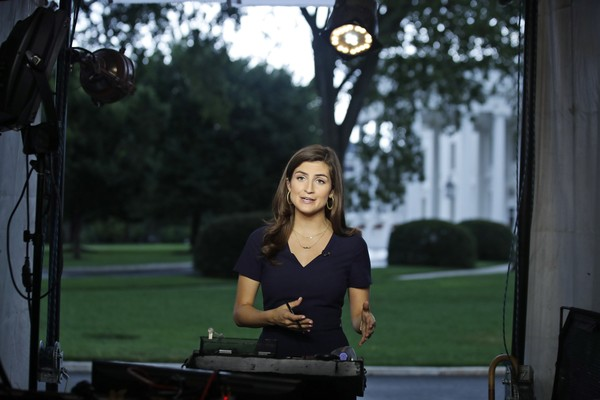 "CNN White House correspondent Kaitlan Collins talks during a live shot in front of the White House, Wednesday, July 25, 2018, in Washington. Collins says the White House denied her access to President Donald Trump's Rose Garden statement with the European Union Commission president because officials found her earlier questions ""inappropriate."" (AP Photo/Alex Brandon)"