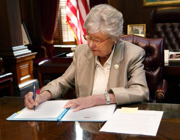 Gov. Kay Ivey signed an executive order today banning the hiring of executives paid by private entities to do work for state agencies. (Governor's office photo)