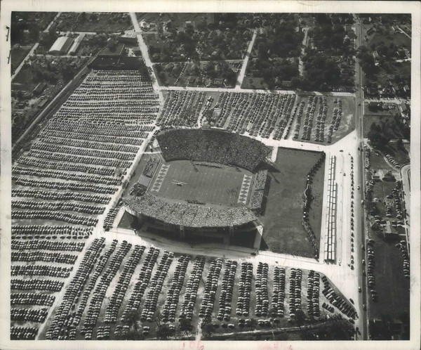 A throng of 36,000 turn out at Ladd Memorial Stadium in 1951 for a football game pitting Auburn against Ole Miss. In the parking lots ringing the field are an estimated 4,500 cars. (Thigpen Photography)