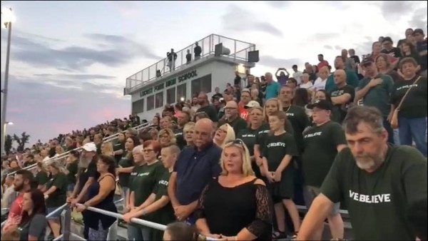 Spectators wore T-shirts with the Lord's Prayer written on them to the Locust Fork football game Friday night in response to the school board no longer allowing prayer over the loudspeaker before games.