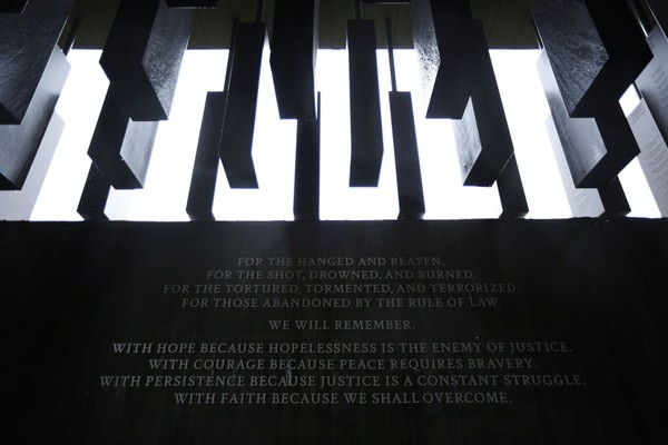 This photo shows part of the National Memorial for Peace and Justice, a new memorial to honor thousands of people killed in racist lynchings, Sunday, April 22, 2018, in Montgomery, Ala. The national memorial aims to teach about America's past in hope of promoting understanding and healing. It's scheduled to open on Thursday. (AP Photo/Brynn Anderson)