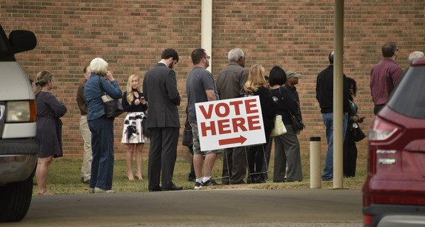 Voters waiting in line outside Little Indian Creek Primitive Baptist Church in Monrovia outside of Huntsville for the November 2016 presidential election.