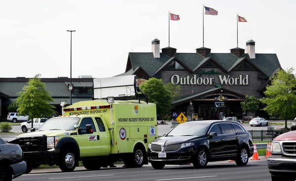 An emergency vehicle redirects traffic outside Opry Mills mall Thursday, May 3, 2018, in Nashville, Tenn. Nashville police said a suspect was taken into custody after a person was shot inside the mall. The mall was evacuated after the gunfire was reported. One person was taken to a hospital and was reported to be in critical condition.
