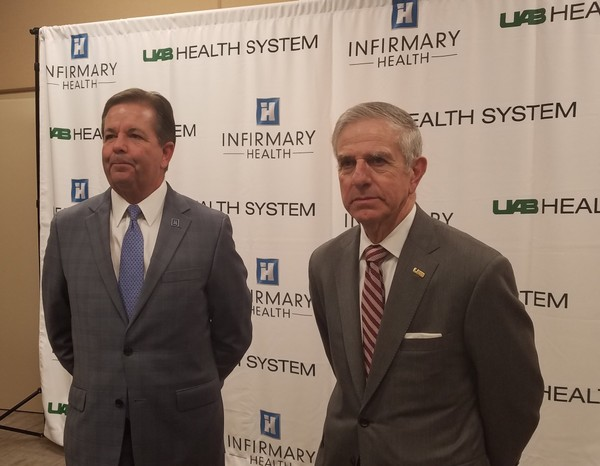 Mark Nix, left, President and CEO of Infirmary Health System, and Dr. William Ferniany, CEO of UAB Health System, speak about an alliance between the two institutions. (Lawrence Specker/LSpecker@AL.com)