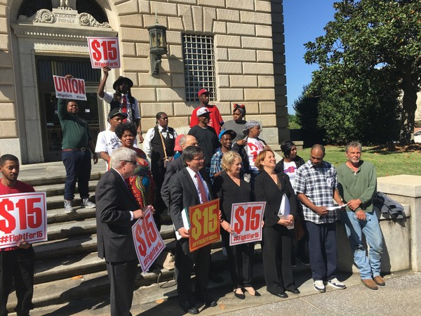 Fast food workers, attorneys and others challenging a law that blocked Birmingham's minimum wage rally at the federal courthouse in Montgomery.