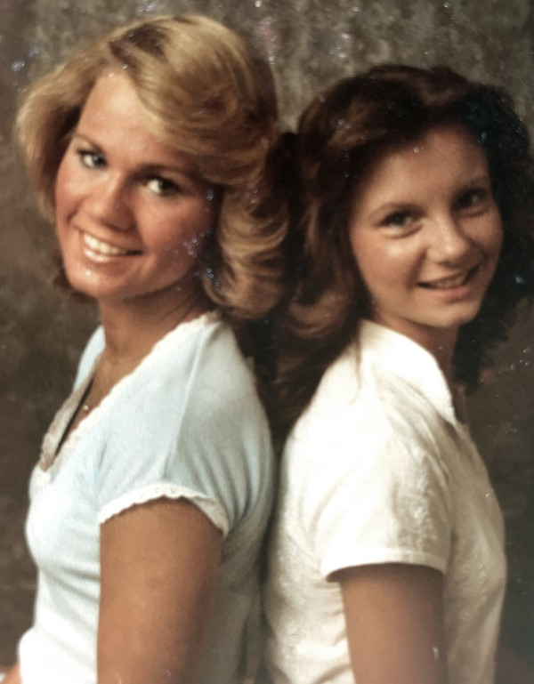 Kayla McLaughlin, left, and Gena Richardson -- seen in 1977 -- worked at Sears during their senior year of high school. Richardson says Moore visited her at the store and called her school to ask her out. Must credit: Photo provided by Kayla McLaughlin