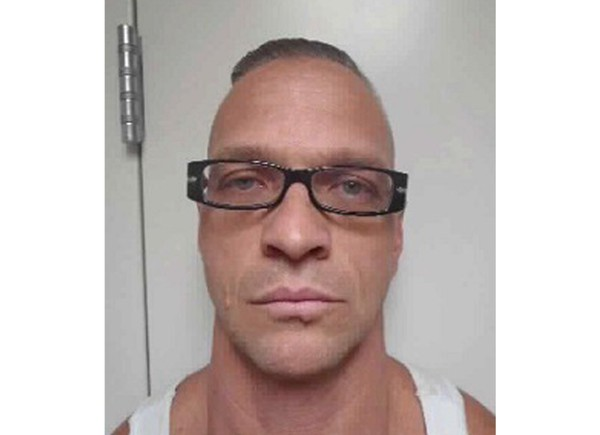 This undated Nevada Department of Corrections photo shows death row inmate Scott Raymond Dozier, who was convicted in 2007 of robbing, killing and dismembering a 22-year-old man in Las Vegas, and was convicted in Arizona in 2005 of another murder and dismemberment near Phoenix. Dozier is slated to die Wednesday, July 11, 2018, by a three-drug lethal injection combination never before tried in any state and has said repeatedly he wants his sentence carried out and he doesn't care if it's painful. (Nevada Department of Corrections via AP)