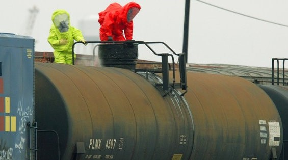 In a file photo from 2005, members of the Mobile Fire-Rescue Department Hazardous Materials Unit check a railroad tanker car leaking ammonia in a railyard north of downtown Mobile. More than a decade later, community advocates say residents in the area still don't get adequate notice of potential hazmat threats.