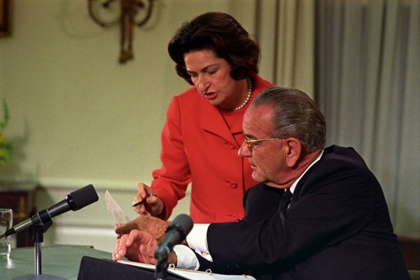 Lady Bird Johnson and President Lyndon B. Johnson review the text of the speech delivered by the president on March 31, 1968. MUST CREDIT: LBJ Library photo by Yoichi Okamoto