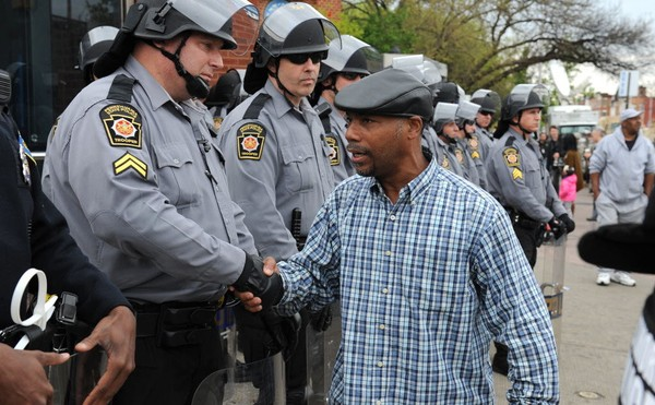 "In this 2015 photo, Glenn Wooden of Baltimore shakes hands with Pennsylvania State Troopers standing along North Avenue on May 1, 2015, after charges were filed against six Baltimore police officers in the death of Freddie Gray in Baltimore, Md. In Alabama, state Sen. Rodger Smitherman, D-Birmingham, has repeatedly pitched legislation to address incidences of racial profiling. His latest proposal, SB84, failed to win the Legislature's support during the end of the 2018 legislative session. ""We have to deal with what is happening so we can provide a framework so this state doesn't have the same situations as you had in Baltimore or Missouri where the reaction was explosive because of someone being profiled."" (Jerry Jackson/Baltimore Sun/TNS)"
