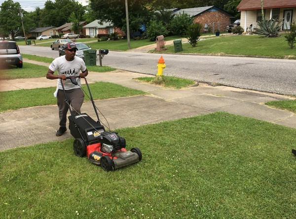 Rodney Smith mows a yard in Montgomery as part of his 50 States 50 Lawns tour. Alabama is the 25th state on his route. It's the second straight year for the tour.